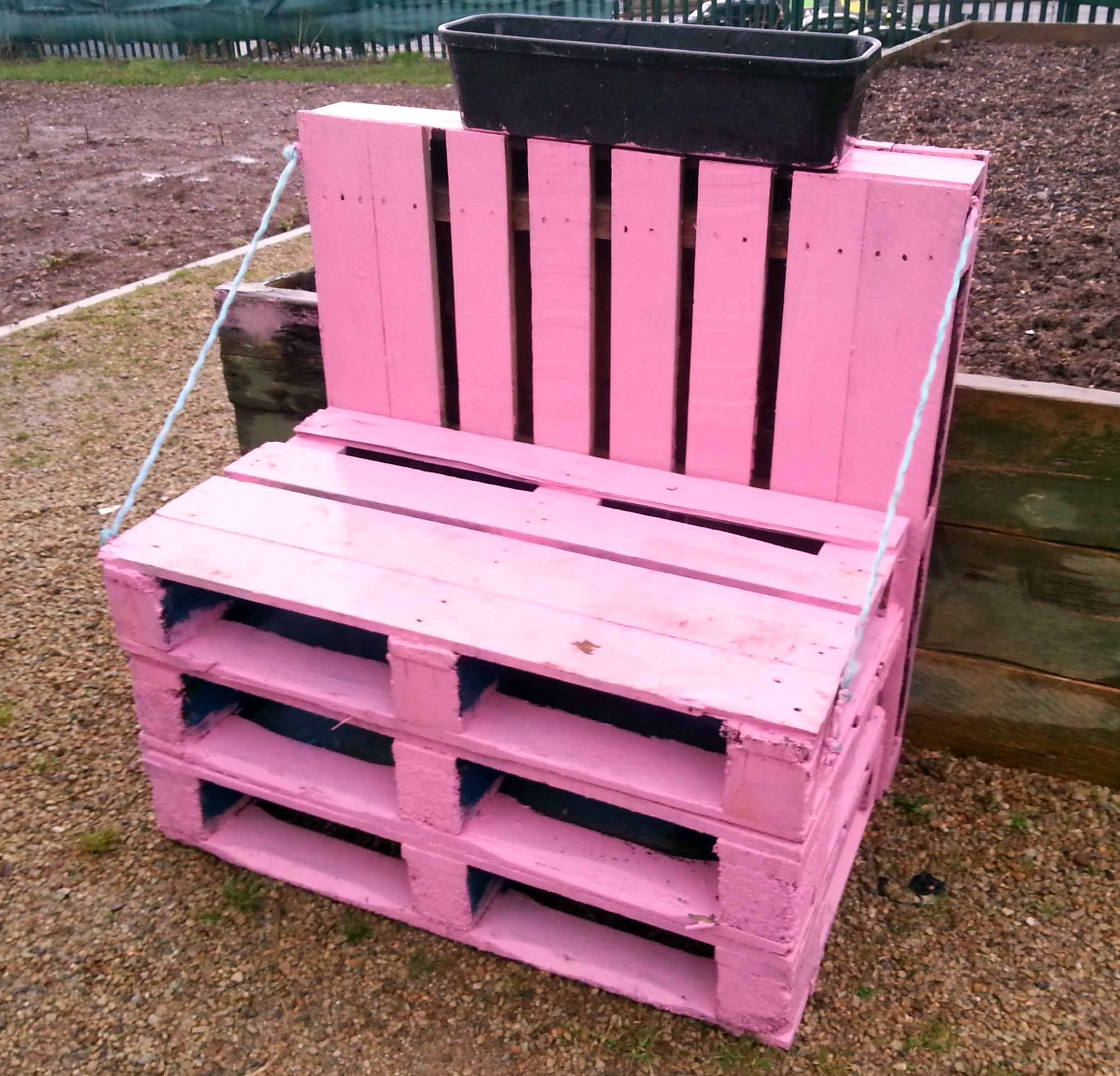 Upcycled pallet seating in a community garden