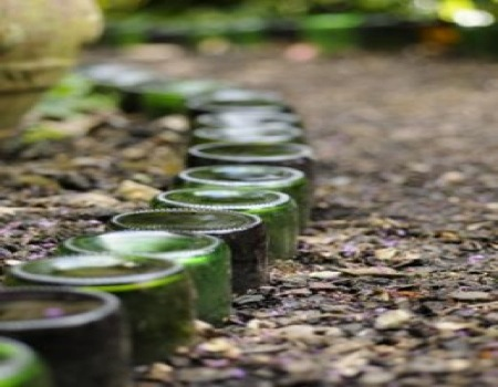 Recycled glass bottles greenside upgreenside up for Alternative garden edging