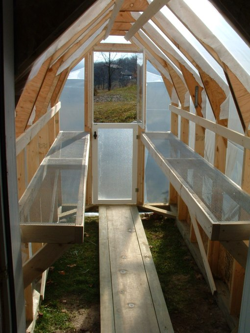 Shelving in a lovely home made greenhouse from A Thin Man's Blog (go see how he made it)